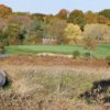 Autumn view of a green at the Meadow At Peabody