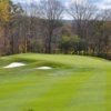 A view of the 13th hole protected by some bunkers at Cold Spring Country Club