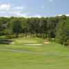 A view of a green surrounded by water at Cummaquid Golf Club