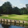 A view over the water of a hole at Willowbend Country Club