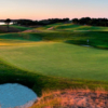 A view of a green guarded by tricky bunkers at Eastward Ho Country Club