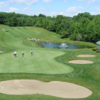 A view of a green protected by bunkers at Donnybrook Country Club