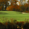 A view of a green flanked by sand traps at Ledgemont Country Club
