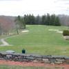 A view of a tee and a fairway at Elmridge Golf Club