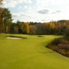 A view of a green protected by bunkers at Boston Golf Club
