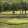 A view of a green protected by bunkers at Brae Burn Country Club