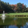 A view of a green with water coming into play at Simsbury Farms Golf Club