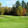 A view of a green protected by bunkers at Orleans Country Club