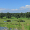 A view of a green with water coming into play at Meadows Golf Course