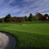 A view of a green protected by bunkers at Ridgewood Country Club