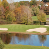 A view of the 15th green with water and bunkers coming into play at Whitney Farms Golf Club