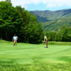 A sunny day view of a hole at Sugarbush Golf Course