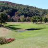 A view of the 12th hole protected by bunkers at White Mountain Country Club