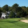 A view of green #9 protected by a bunker at Hyannis Golf Club