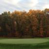A fall day view of a green at Manchester Country Club