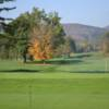 A fall day view of a green at Taconic Golf Club