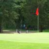 A nice calm day view of a green at Cedar Glen Golf Club