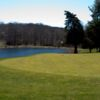 A view of a green with water in background at Cedar Ridge Golf Course.