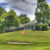 A view of a green and the clubhouse at Norfolk Country Club.